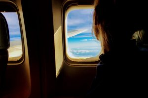 Girl in plane cheap flights